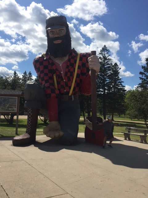 Huge statue of Paul Bunyan. That's me with my bum on the axe blade (about as comfortable as a bike seat.)